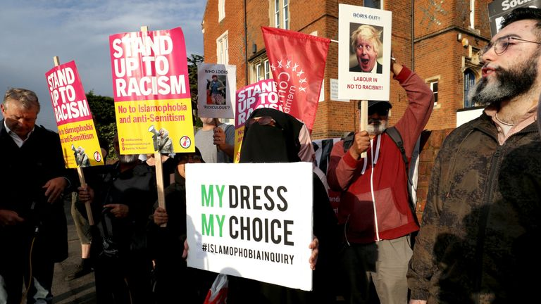 A woman wearing a burka joins the protest near Boris Johnson's Uxbridge and South Ruislip Conservative office on Harefield Road in Uxbridge.