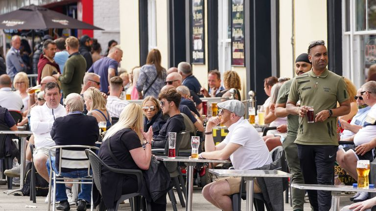 People enjoy a drink at a pub along the seafront in Southend, with the bank holiday weekend expected to bring blue skies and widespread sunshine. Picture date: Sunday May 30, 2021.