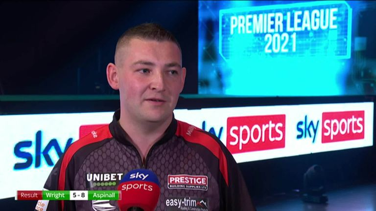 Nathan Aspinall says he had to grind out a victory against Peter Wright