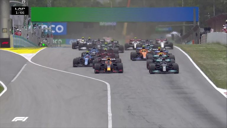Max Verstappen is the early race leader in the Spanish Grand Prix after out-manoeuvring Lewis Hamilton on the first corner
