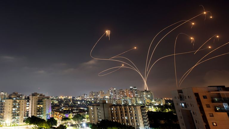 Israel's Iron Dome anti-missile system intercepts rockets launched from the Gaza Strip in pictures taken with slow shutter speed
