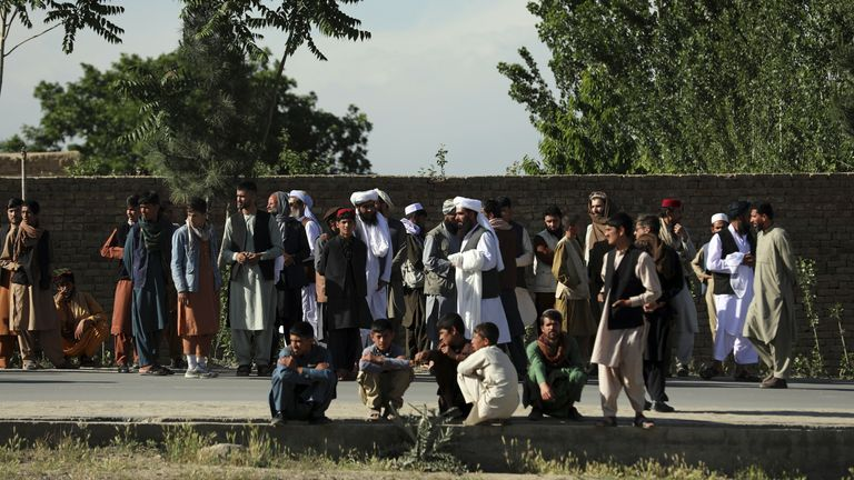 People gather at the scene of the explosion in Shakar Dara district Pic: AP