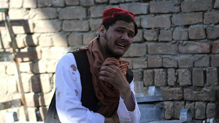 A witness visibly in distress after the bombing in Kabul during Friday prayers Pic: AP