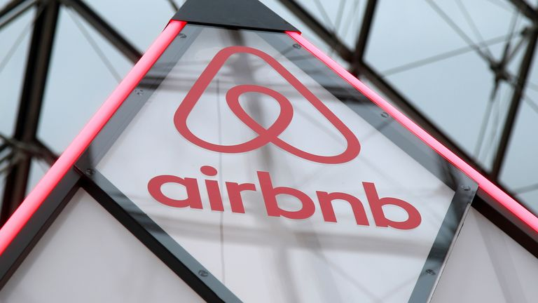 FILE PHOTO: The Airbnb logo is seen on a little mini pyramid under the glass Pyramid of the Louvre museum in Paris, France, March 12, 2019
