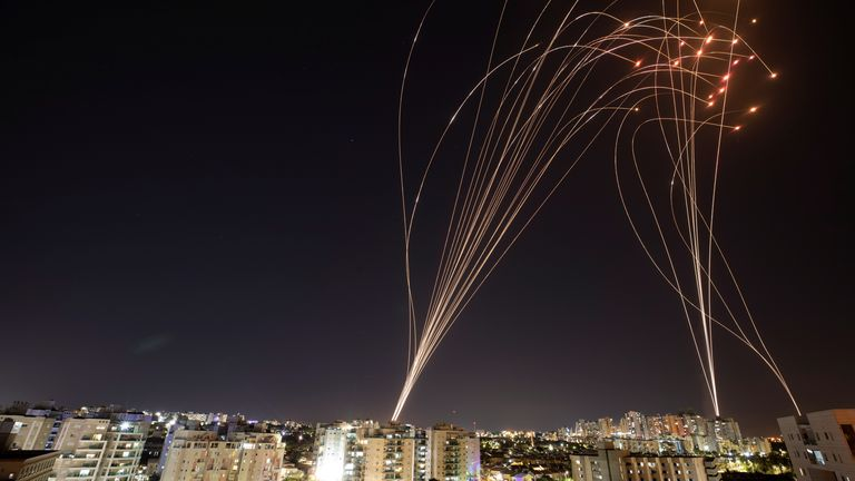 Streaks of light are seen in Ashkelon as Israel's Iron Dome anti-missile system intercepts rockets launched from the Gaza Strip towards Israel