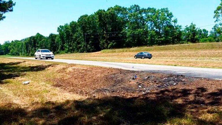 Charred remnants at the scene of the crash