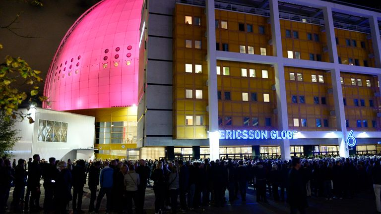 FILE - In this photo taken Monday, Sept. 21, 2015, people queue outside the Globe Arena for a U2 concert in Stockholm, Sweden on Sept. 21, 2015. The indoor arena in Stockholm, which first opened in 1989, is being renamed AVICII ARENA, named after DJ Avicii, born Tim Bergling, who died by suicide at age 28 in 2018. (Pontus Lundahl/TT News Agency via AP) SWEDEN OUT
