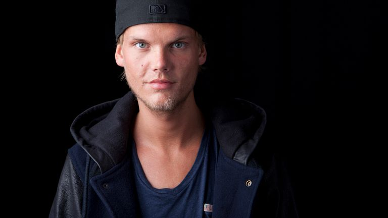 FILE - Swedish DJ, remixer and record producer Avicii poses for a portrait, in New York on Aug. 30, 2013. The indoor arena in Stockholm, which first opened in 1989, is being renamed AVICII ARENA. Avicii, born Tim Bergling, died at age 28 in 2018 by suicide. (Photo by Amy Sussman/Invision/AP, File)