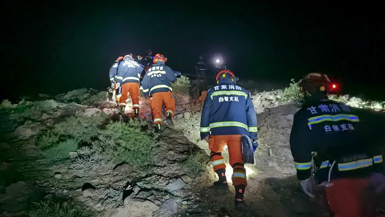 China Gansu Jingtai Marathon Extreme Weather - 23 May 2021. Rescuers search for missing people at the Yellow River Stone Forest tourist site in Jingtai County of Baiyin City, northwest China's Gansu Province, May 23, 2021