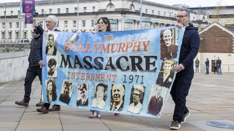 Families of people who were killed at Ballymurphy outside the International Convention Centre in Belfast