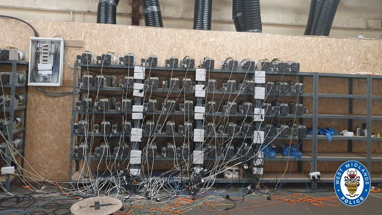An array of around 100 machines was discovered in the industrial unit. Pic: West Midlands Police