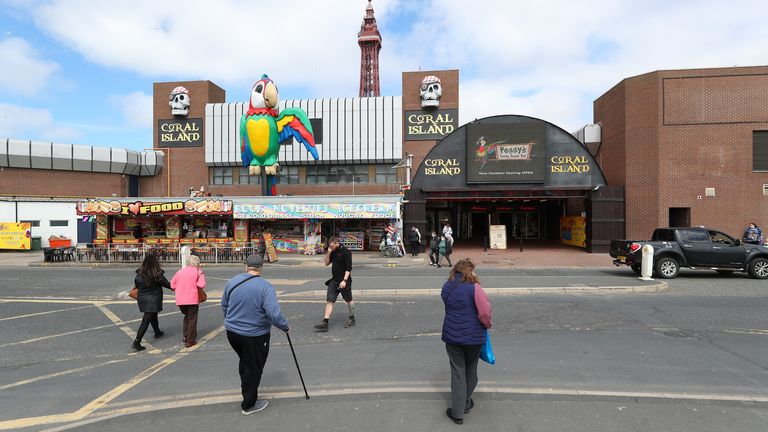 People outside the Coral Island amusement arcade in Blackpool earlier this week