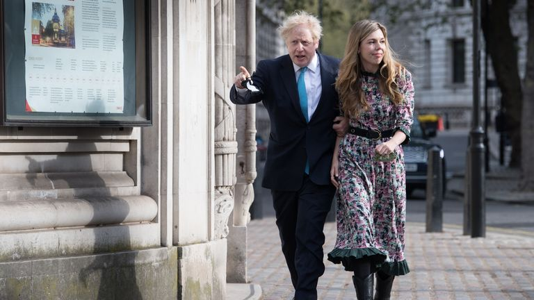 Prime Minister Boris Johnson and his fiancee Carrie Symonds leave after casting their vote at Methodist Central Hall, central London, in the local and London Mayoral election. Picture date: Thursday May 6, 2021.
