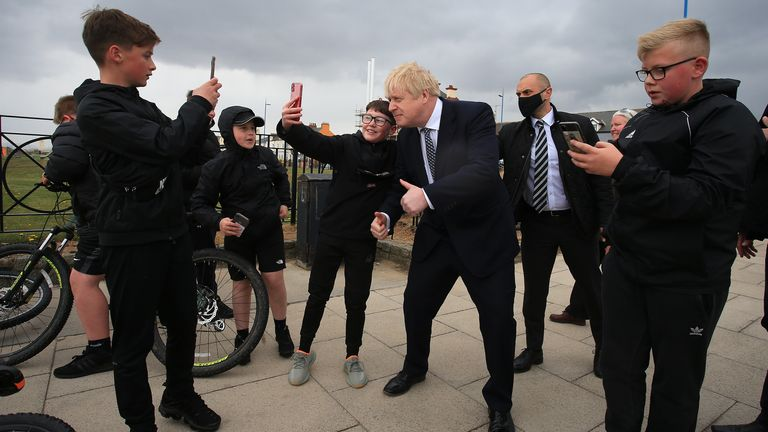 Boris Johnson poses for a 'selfie' as he meets members of the public while campaigning on behalf of Conservative candidate Jill Mortimer in Hartlepool
