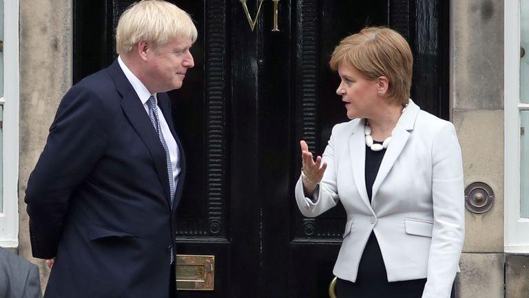Scotland's First Minister Nicola Sturgeon welcomes Prime Minister Boris Johnson outside Bute House in Edinburgh