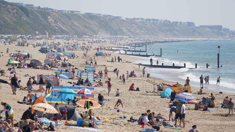 People gather in the good weather at Boscombe beach, Dorset, as Bank Holiday Monday could be the hottest day of the year so far - with temperatures predicted to hit 25C in parts of the UK. Picture date: Monday May 31, 2021.