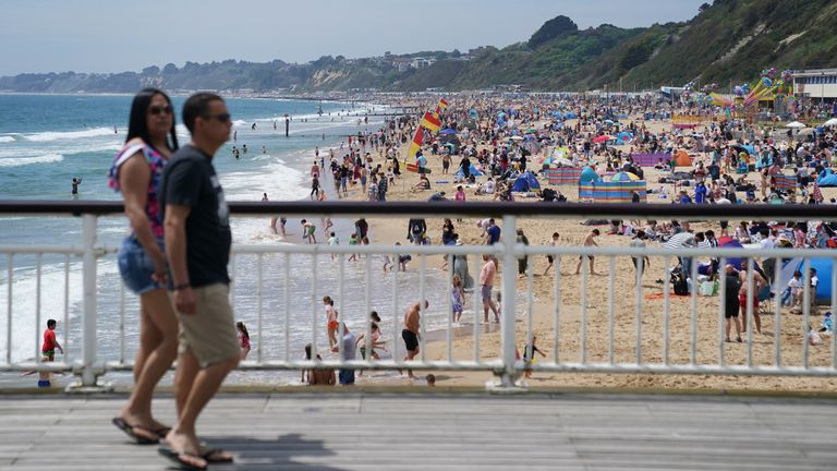 People enjoy the warm weather on Bournemouth beach, with the bank holiday weekend expected to bring blue skies and widespread sunshine. Picture date: Sunday May 30, 2021.