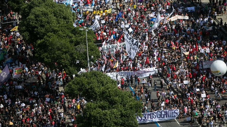 People in Rio de Janeiro march in a protest against the government's handing of the pandemic