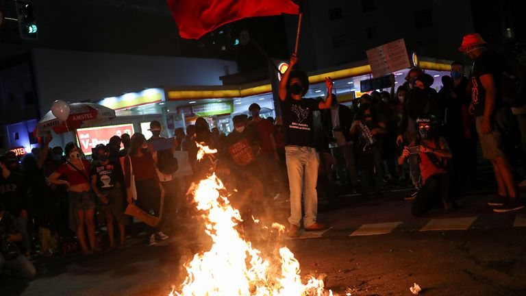 Protestors in Sao Paulo burned a doll depicting Mr Bolsonaro during the demonstration