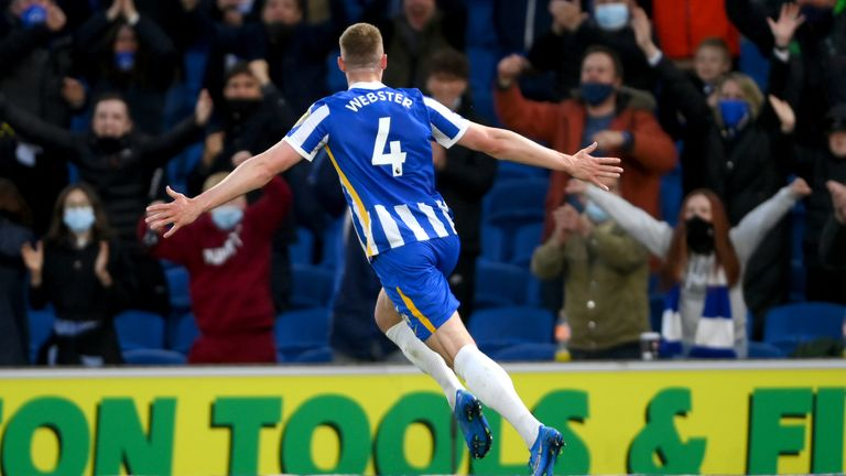 Brighton and Hove Albion's Adam Webster celebrates scoring their side's second goal of the game in front of the home fans during the Premier League match at the AMEX Stadium, Brighton. Picture date: Tuesday May 18, 2021.