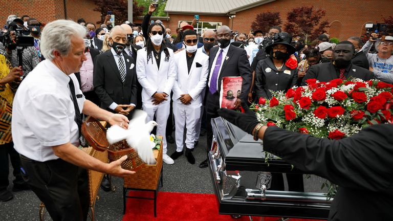 A dove representing the soul of Andrew Brown Jr. is released as his sons Khalil and Jha'rod Ferebee, other family members and the Reverend Al Sharpton watch at the conclusion of the funeral in Elizabeth City, North Carolina, U.S., May 3, 2021. REUTERS/Jonathan Drake