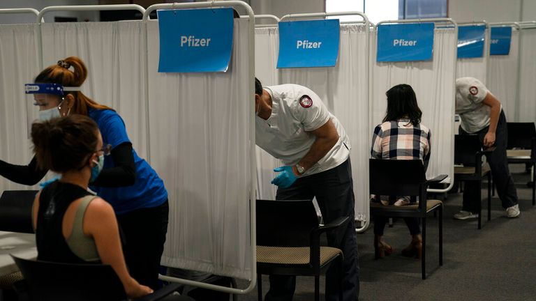 Vaccines are handed out a centre in Santa Ana, California. Pic: AP