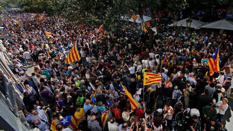 A crowd of protestors gather outside the Catalan region's economy ministry building in Barcelona in 2017. Pic: AP