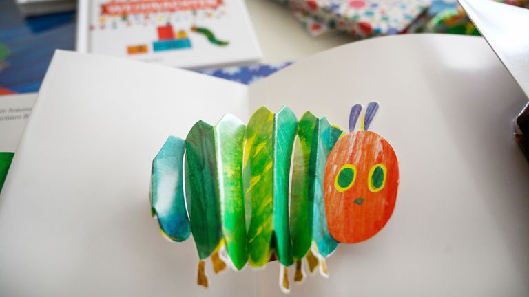 """15 May 2019, Lower Saxony, Hildesheim: An edition of the book """"Die kleine Raupe Nimmersatt"""" as a pop-up version of the children's book author Eric Carle lies open on a table. (to dpa """"Timelessly loved: Little caterpillar Nimmersatt celebrates 50th birthday"""") Photo by: Christophe Gateau/picture-alliance/dpa/AP Images"""