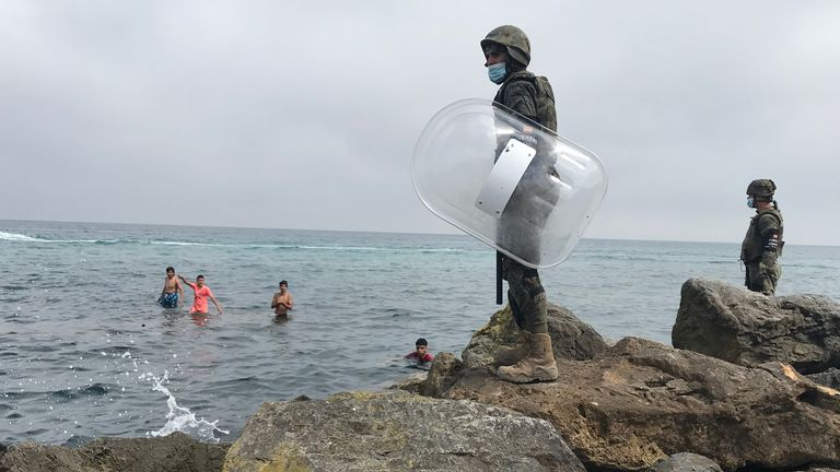 Soldiers have been waiting to intercept the swimmers