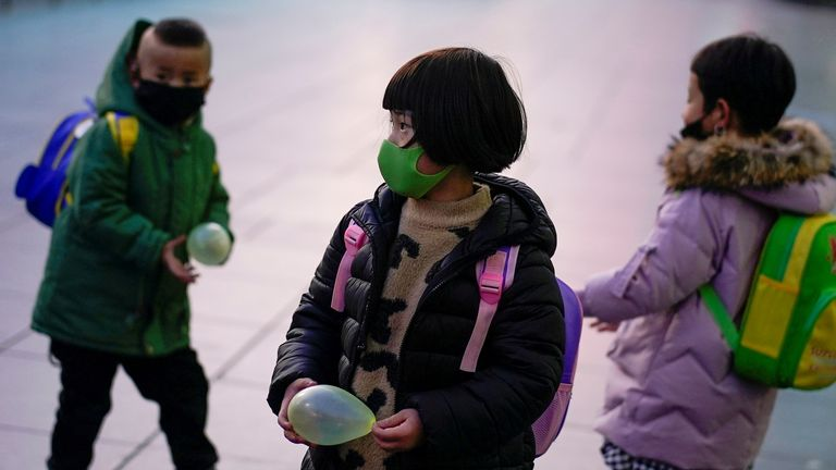FILE PHOTO: Children wearing face masks are seen at Shanghai railway station in Shanghai, China March 5, 2020. REUTERS/Aly Song/File Photo