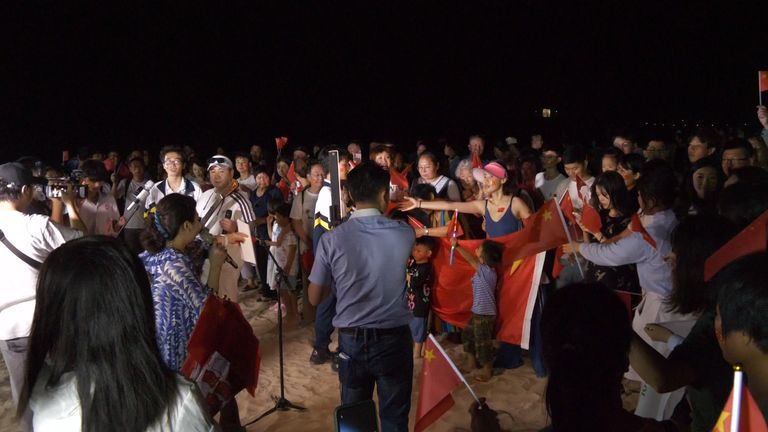 People gathered on the beach in Wenchang to watch the launch
