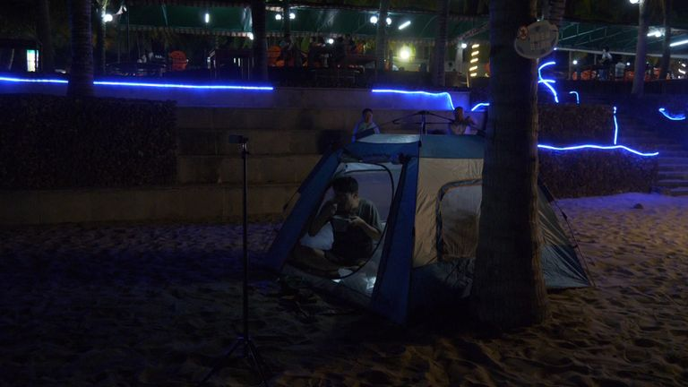 One viewer was spotted in a tent as he waited for the rocket to launch