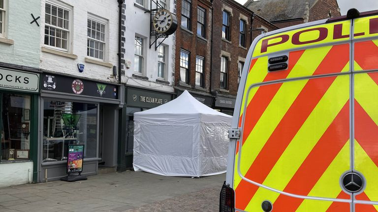 A police tent outside The Clean Plate cafe in Southgate Street, Gloucester. Picture date: Tuesday May 11, 2021.