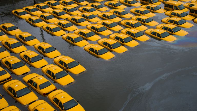 A parking lot full of yellow cabs is flooded as a result of superstorm Sandy on Tuesday, Oct. 30, 2012 in Hoboken, NJ. (AP Photo/Charles Sykes)