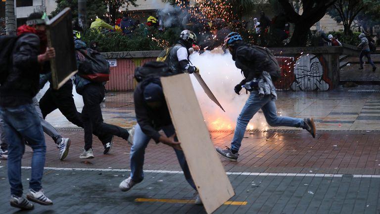 Riot police threw tear gas at protestors in Bogota