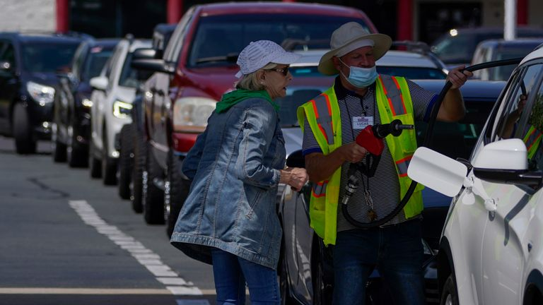 Long queues of cars were seen in parts of the East Coast, including Charlotte North Carolina. The Colonial Pipeline delivers 45% of fuel to the East Coast. Pic AP
