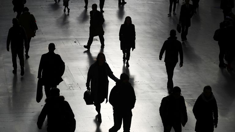 Commuters walk through Waterloo station during rush hour, as the number of Coronavirus cases grow around the world, in London, Britain, March 17, 2020. REUTERS/Hannah McKay
