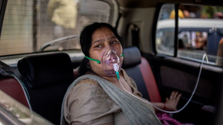 A woman breathes with the help of Oxygen in New Delhi