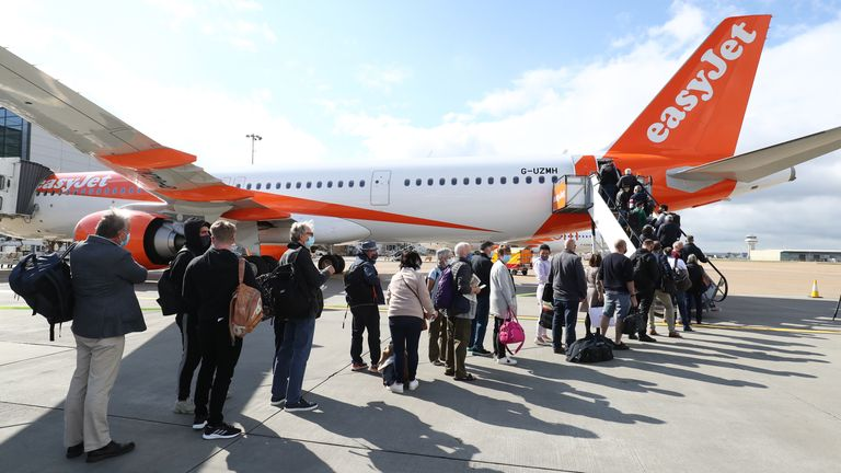 Passengers at Gatwick airport board a flight to Faro in Portugal