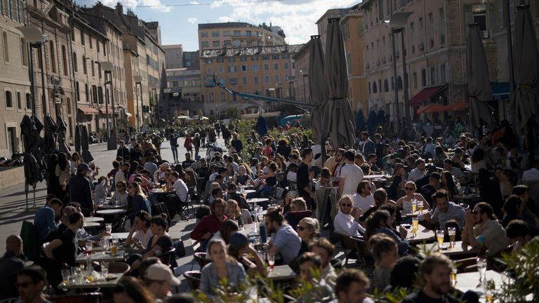 People drink outdoors at bar terraces in Marseille, southern France
