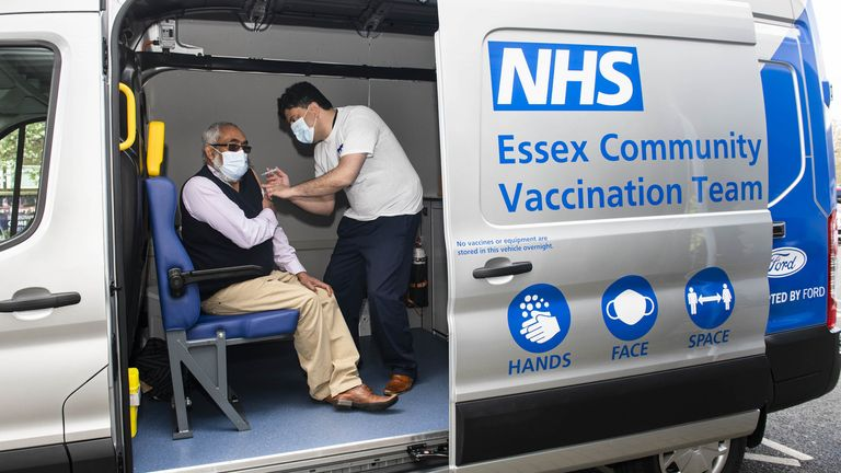 A man receives his jab inside a bespoke mobile vaccination van aimed at targeting vulnerable communities