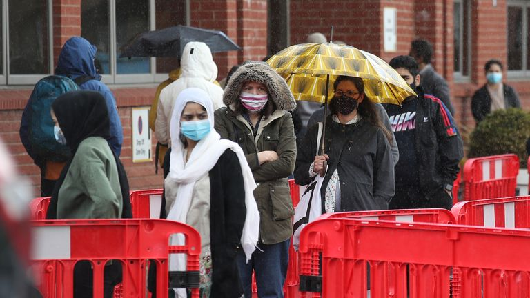 People queuing in the car park for a vaccination at the Glasgow Central Mosque