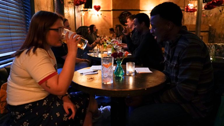 A gradual reopening of the economy has allowed people back inside pubs and restaurants. Pic: AP