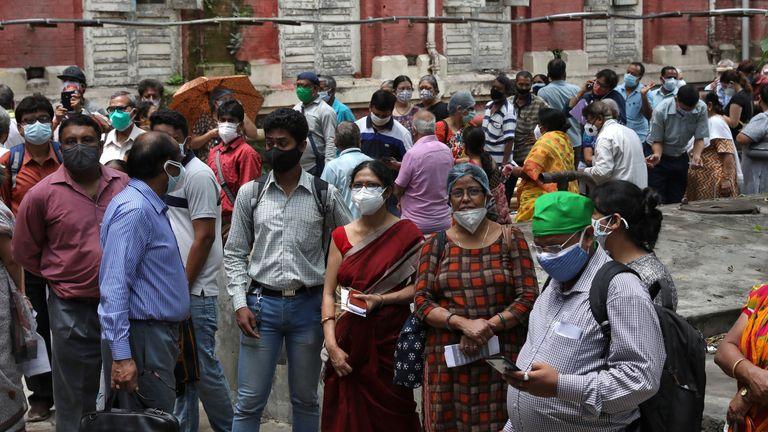 People waiting for a second dose of COVISHIELD, a coronavirus vaccine, in Kolkata