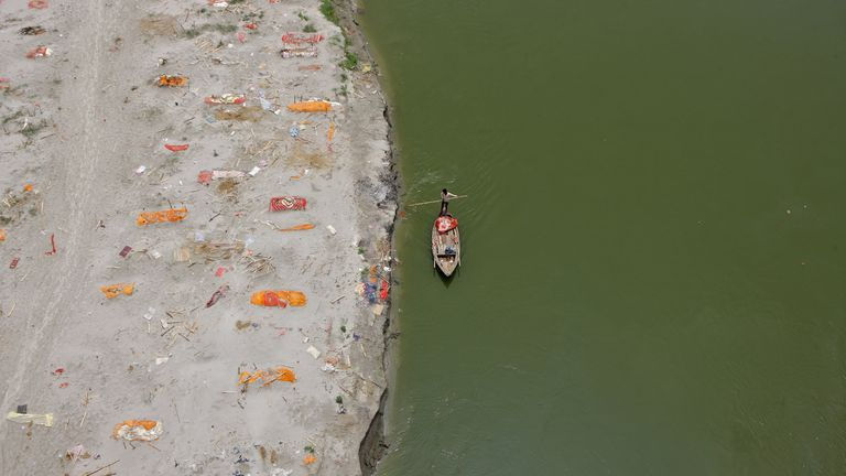 Shallow sand graves on the Ganges, some of which are believed to be COVID victims