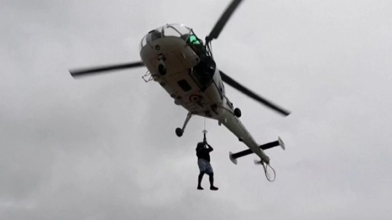 The Indian Navy mounted a massive air and sea rescue mission  for oil workers and crew at a lighthouse.