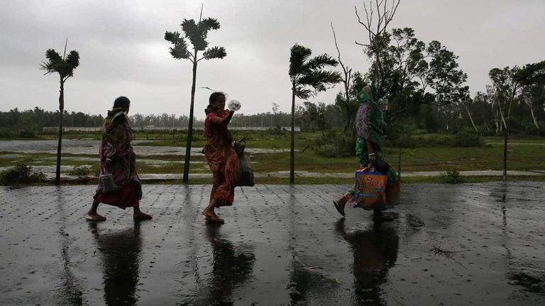 People move to a safer place as the cyclone approaches the eastern state of West Bengal