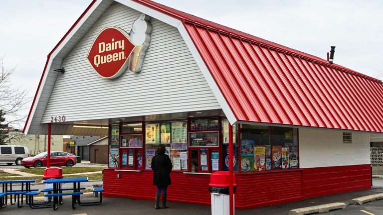 This local Dairy Queen restaurant has sign posted Open For Take Away while customers are asked to stand away from the window while ordering during the State of Michigan mandated COVID-19 Coronavirus closure period on Thursday March 19, 2020 in Ann Arbor, MI. Pic: AP
