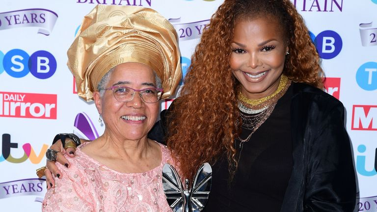 Dame Elizabeth Anionwu with her lifetime achievement award, presented by Janet Jackson, at the Pride of Britain Awards in 2019