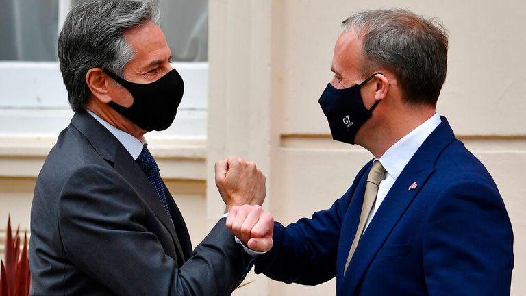 Dominic Raab (R) greets US Secretary of State Antony Blinken by tapping arms